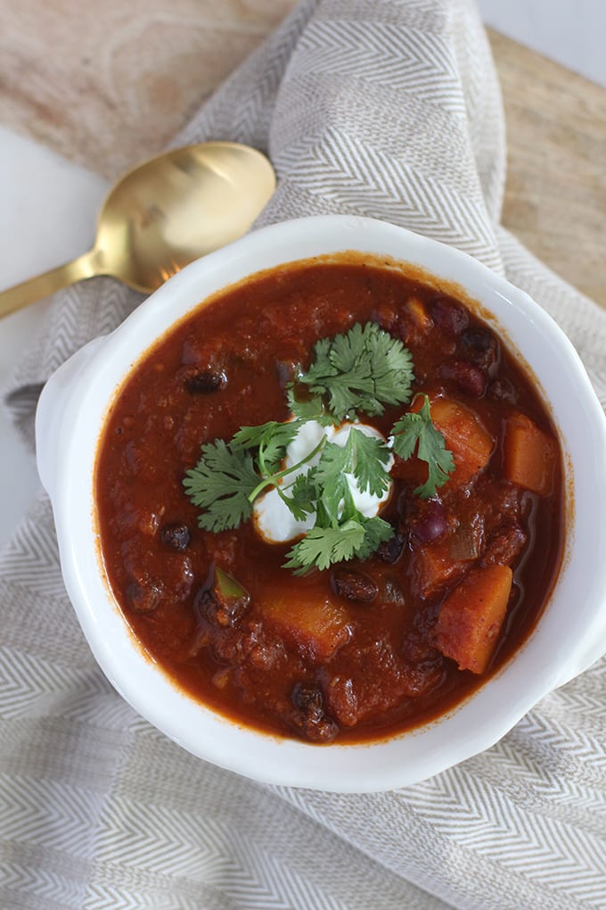Warm up this fall with this hearty chili featuring seasonal veggies! This Butternut Squash Veggie Chili Recipe is a great one for those busy week nights or meal prep days!