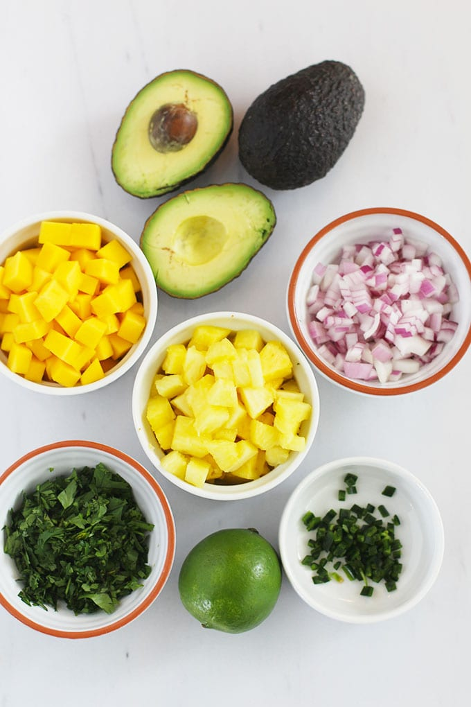 Get the recipe for this insanely easy and delicious Pineapple Mango Guacamole that's made with less than 7 ingredients!