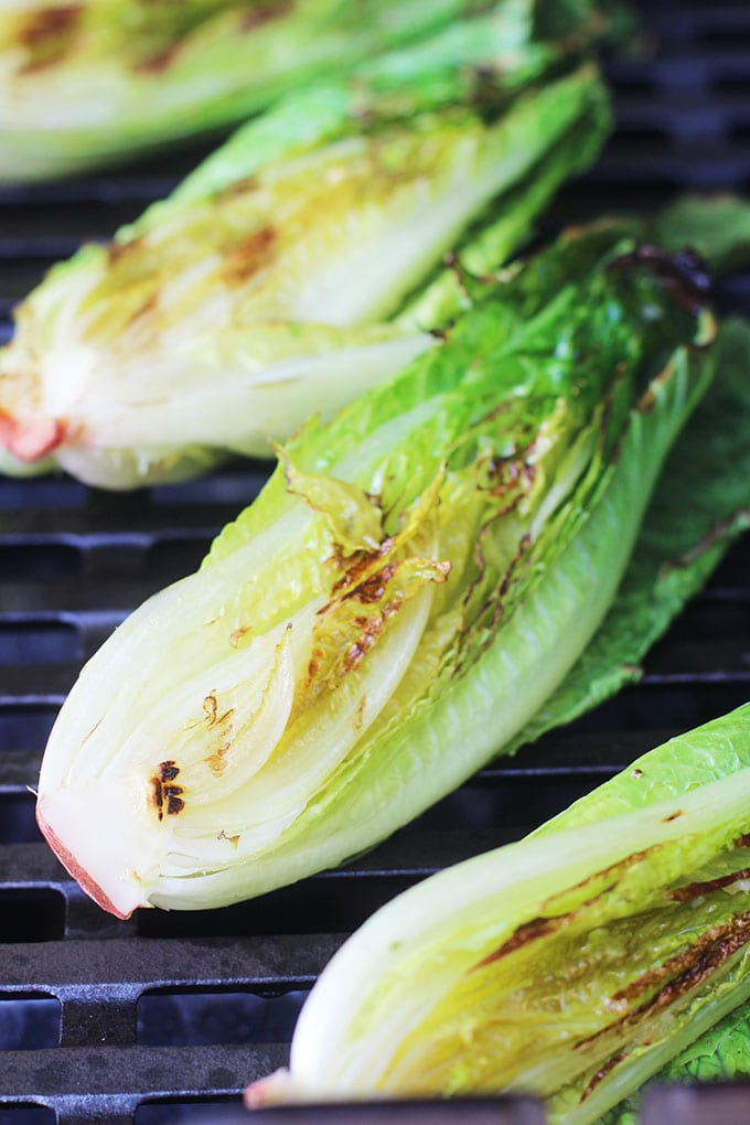 Have you ever tried grilled romaine? It's super simple and stunning! Get the recipe for grilled romaine with a creamy lemon dressing on the blog! | FitLiving Eats
