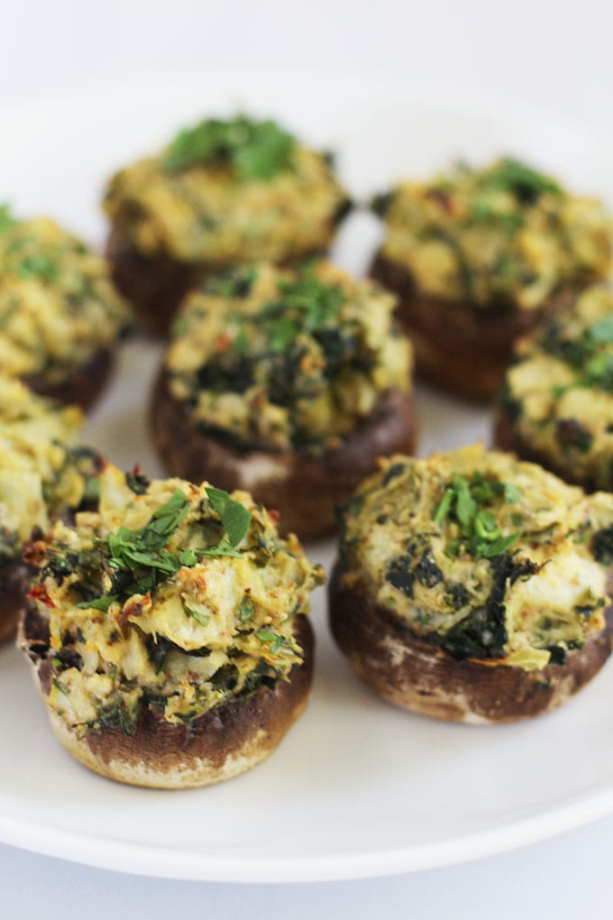 Spinach Artichoke Hummus Stuffed Mushrooms - the perfect party appetizer made with seven ingredients and in under 30 minutes! #sponsored