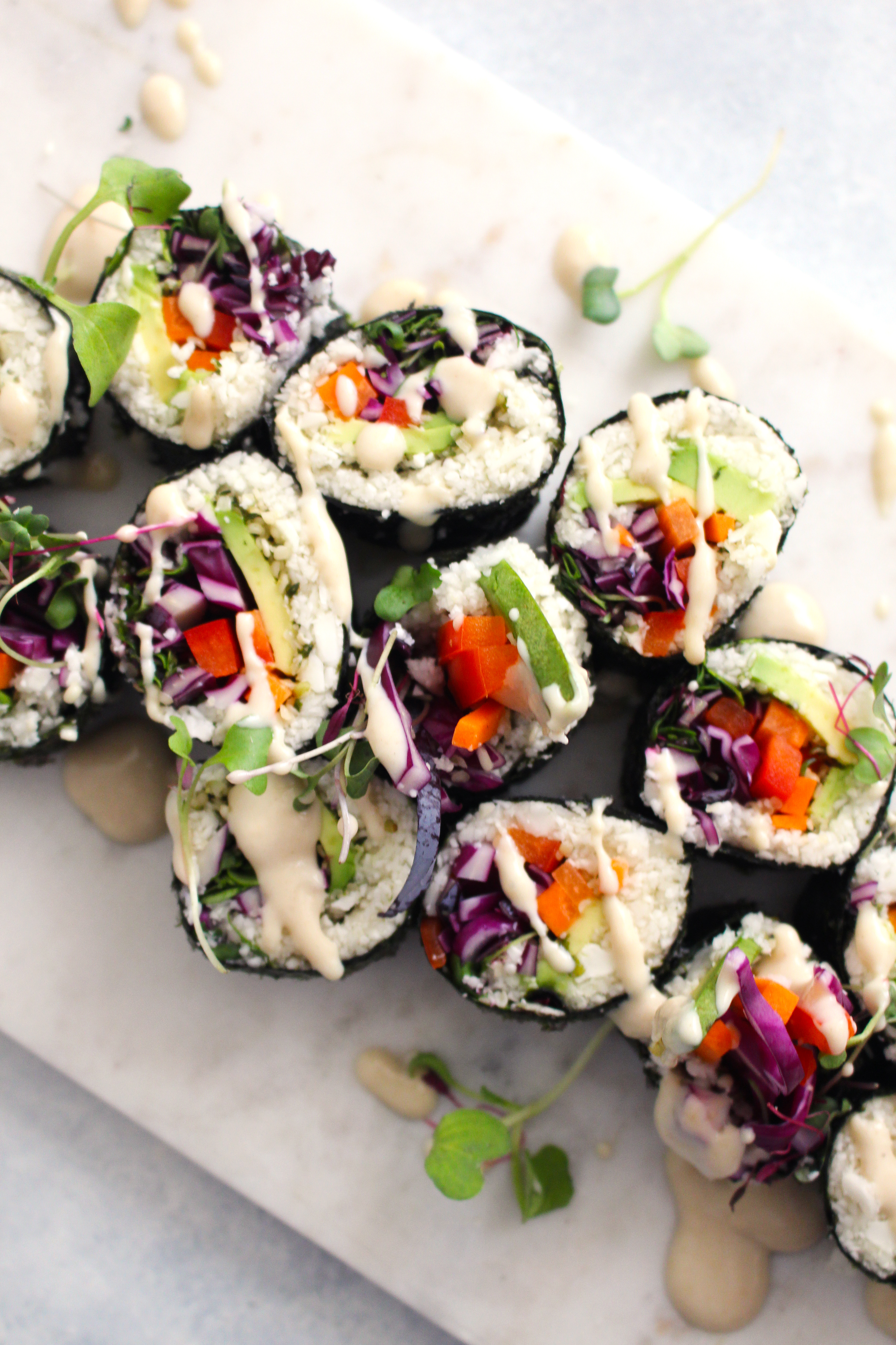 How to make your own homemade vegan sushi rolls + GLOW raw vegan sushi with a miso tahini sauce recipe | FitLiving Eats by Carly Paige